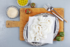 Raw squid rings. On cutting board Royalty Free Stock Photography