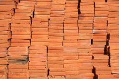 Raw stacked bricks Stock Photos