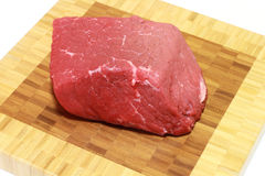 Raw steak. Isolated on cutting board stock photography
