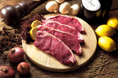 Raw Steak. Placed on chopping board ready for seasoning royalty free stock photos