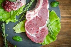 Raw steak black plate top veiw Royalty Free Stock Photos