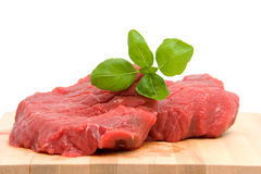 Raw steak on cutting board Stock Photo