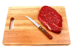 Raw steak on cutting board Royalty Free Stock Photo