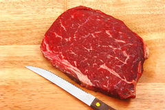 Raw steak on cutting board Royalty Free Stock Photography