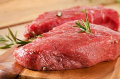 Raw  steak on   cutting board. Stock Photos