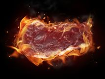 Raw steak in fire Royalty Free Stock Photo