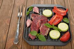 Raw steak and fresh vegetables Royalty Free Stock Photography