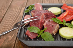 Raw steak and fresh vegetables Royalty Free Stock Image