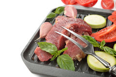 Raw steak and fresh vegetables Stock Images