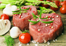 Raw Steak with green asparagus Royalty Free Stock Image