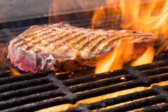 Raw Steak on a Grill Royalty Free Stock Images