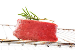 Raw steak on grill. Royalty Free Stock Photos