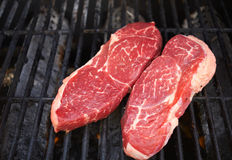 Raw Steak on the grill Royalty Free Stock Photography