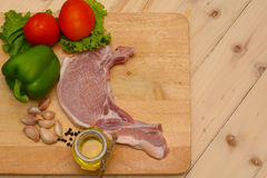 Raw steak with ingredient on wooden board Stock Images
