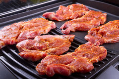Raw steak meat on barbecue Stock Photo