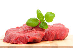 Raw steak meat on cutting board Stock Images