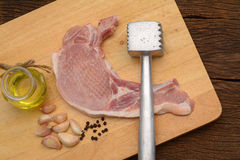 Raw steak with meat hammer and ingredient on wooden board Royalty Free Stock Photography