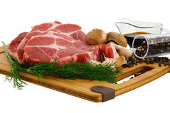 Raw steak with mushrooms dill and spices Royalty Free Stock Photography