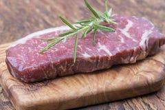 Raw steak. On olive wood Royalty Free Stock Image