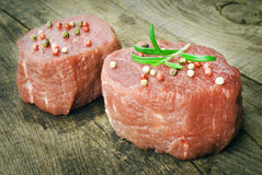 Raw steak with pepper on wood Stock Images