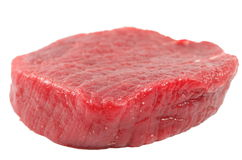 Raw steak. Rare raw steak on a white background Stock Photography