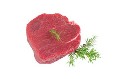 Raw steak. Rare raw steak on a white background Royalty Free Stock Photography