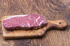 Raw steak. On olive wood Royalty Free Stock Photography