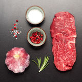Raw steak Ribeye entrecote on black stone background Stock Photography