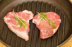 Raw steak with rosemary Royalty Free Stock Photo