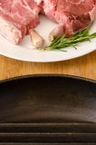 Raw steak with rosemary and garlic Stock Image