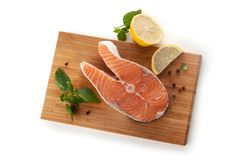 Steak of salmon with lemon and basil Royalty Free Stock Images