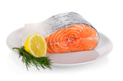 Raw steak of salmon on white plate isolated.  Stock Photo