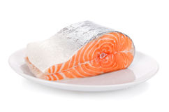 Raw steak of salmon on white plate isolated.  Stock Photography