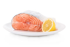 Raw steak of salmon on white plate isolated. On white background Stock Photography