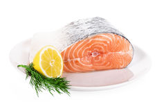 Raw steak of salmon on white plate isolated. On white background Stock Images