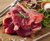 Raw Steak with Seasoning and herbs on  wooden board. Stock Photography