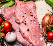 Raw steak turkey tomatoes garlic onion rice in a frying pan top view close up Royalty Free Stock Photography
