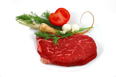 Raw steak and vegetables Stock Image