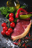 Raw steak with vegetables Royalty Free Stock Photos