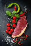 Raw steak with vegetables Royalty Free Stock Image