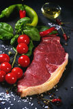 Raw steak with vegetables Stock Photos