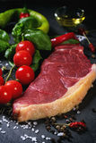 Raw steak with vegetables Stock Images