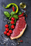 Raw steak with vegetables Royalty Free Stock Photography