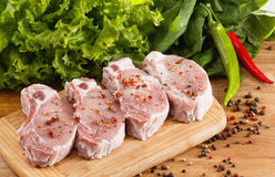 Raw steak with vegetables, spices and herbs Stock Photos