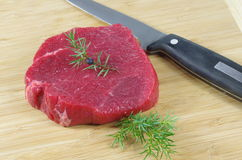 Raw steak. On wooden board Stock Photography