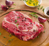 Raw Steak on a  wooden  table. Royalty Free Stock Photo