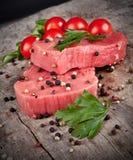 Raw steaks Stock Photos