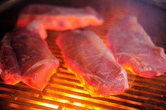 Raw steaks on grill outdoors Royalty Free Stock Image