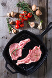 Raw steaks in grill pan ready to cook Royalty Free Stock Image