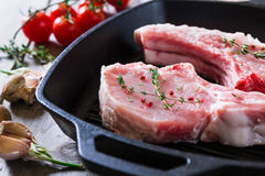 Raw steaks in grill pan ready to cook Stock Images
